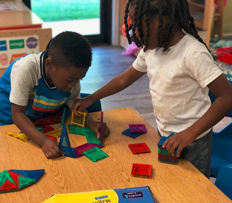 African american little boys playing with colorful magnetic building blocks at a Christian Preschool & Daycare Serving Loganville, GA