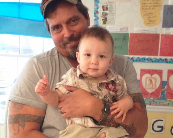 Happy dad and his cute little baby boy at a Christian Preschool & Daycare Serving Loganville, GA