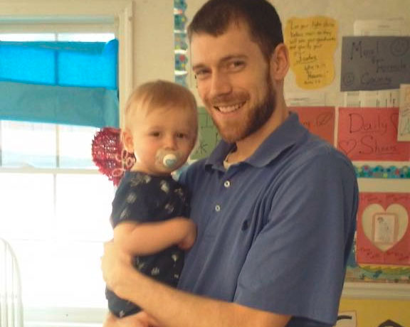 Happy father and his cute little baby at a Christian Preschool & Daycare Serving Loganville, GA
