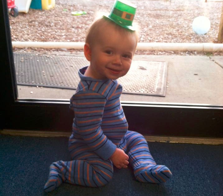 Cute little toddler boy wearing strife with a green hat on his head at a Christian Preschool & Daycare Serving Loganville, GA