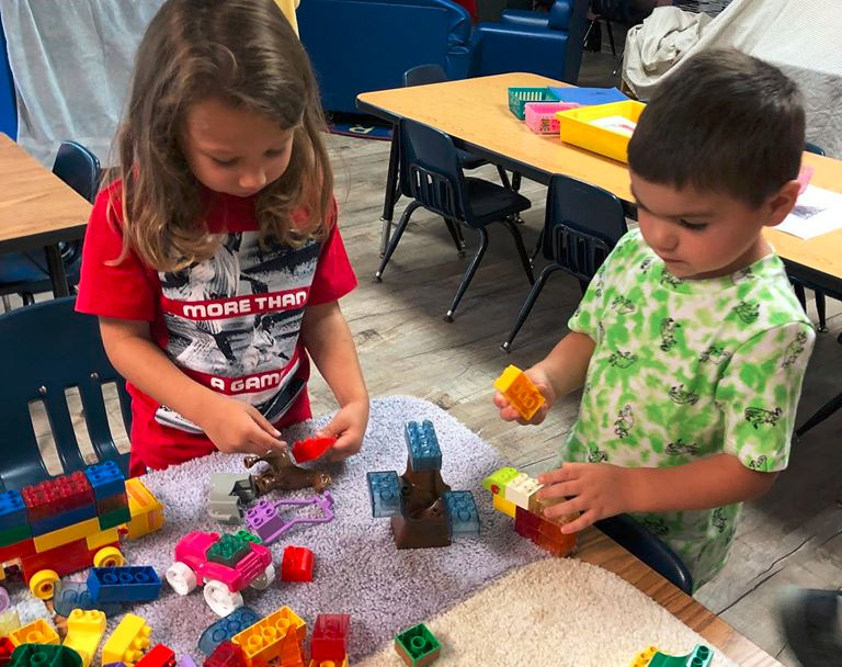 Young little kiddos playing some building block showing creativity at a Christian Preschool & Daycare Serving Loganville, GA
