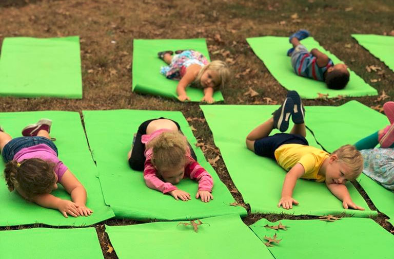 Group of kids doing yoga on the playground at a Christian Preschool & Daycare Serving Loganville, GA