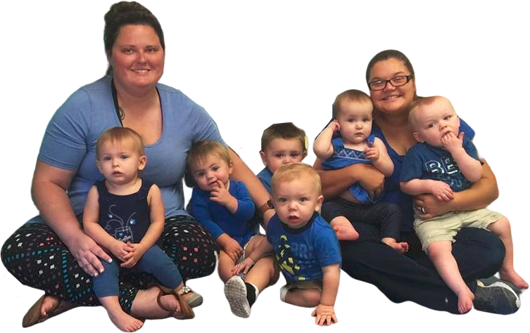 Happy teachers and cute little babies wearing blue at a Christian Preschool & Daycare Serving Loganville, GA
