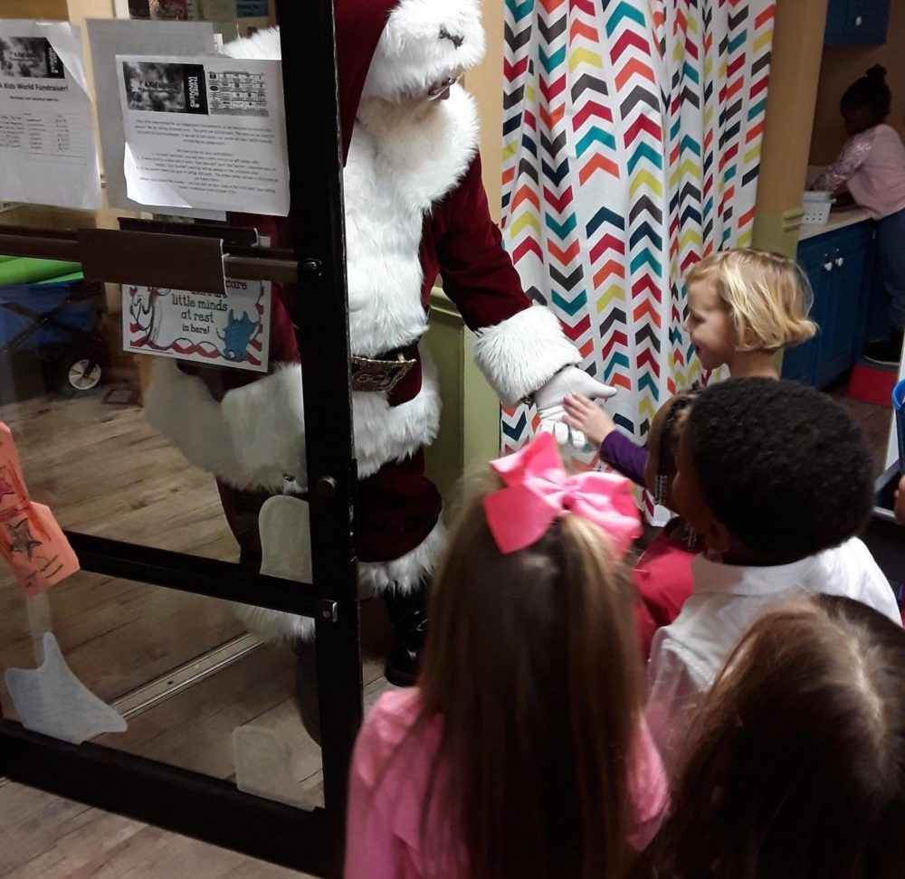 Santa clause in costume visiting nursery kids at a Christian Preschool & Daycare Serving Loganville, GA