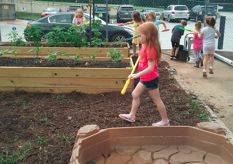 kids in garden at a Christain Preschool & Daycare Serving Loganville, GA